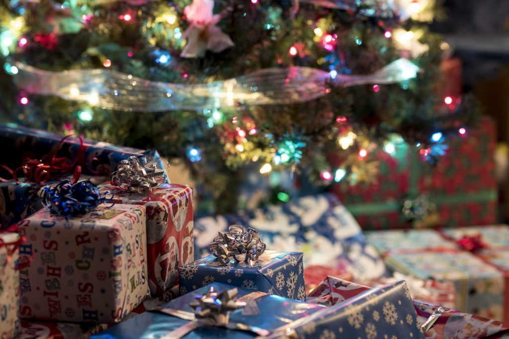 Christmas gifts delivered by Father Christmas under a Christmas tree